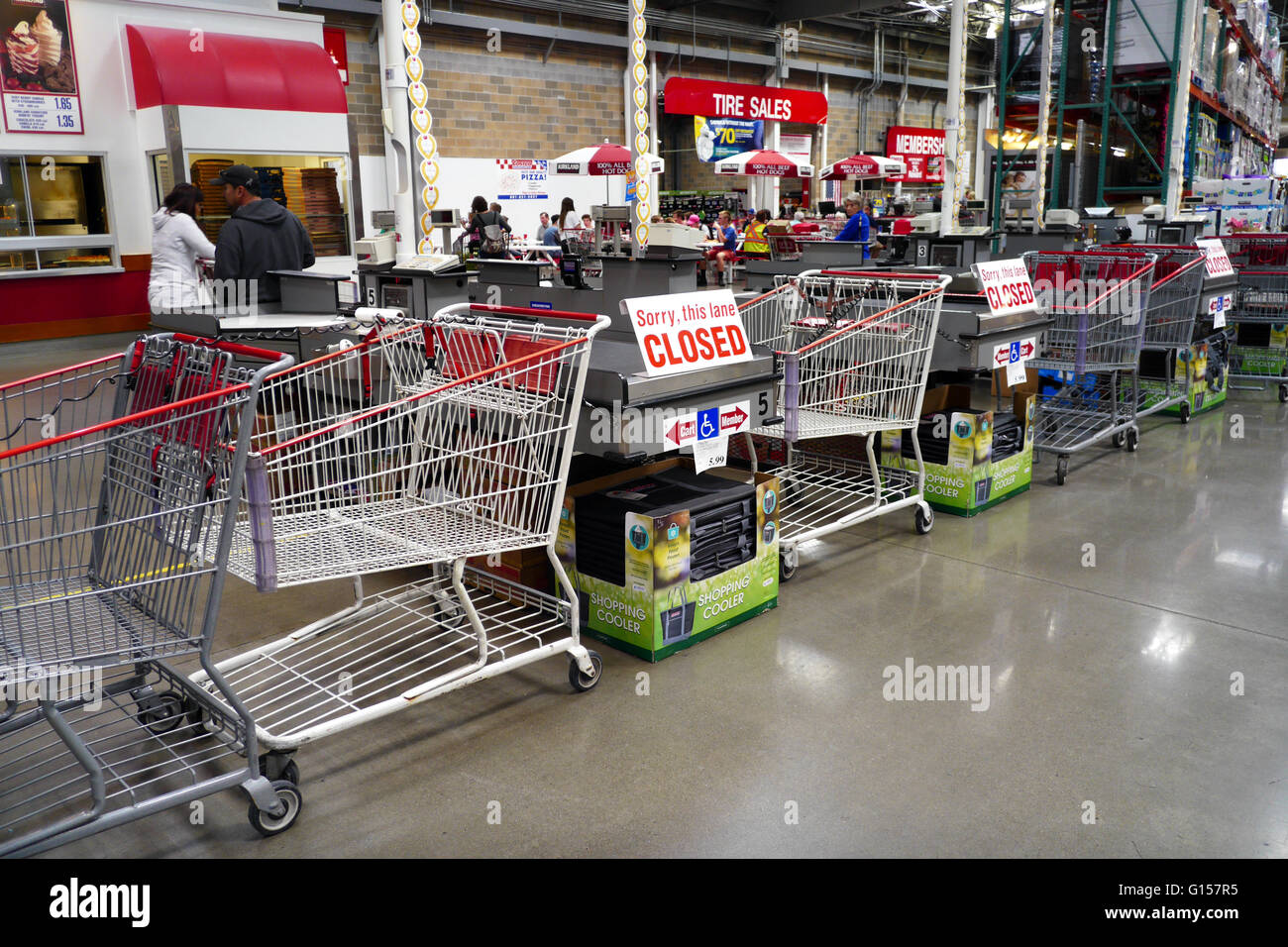 """Multiple closed and blocked aisles with """"Sorry, this lane CLOSED"""" signs on them at a busy warehouse store. Stock Photo"""