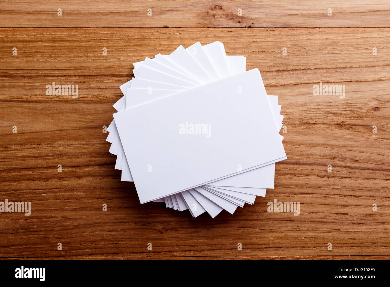 Business card stack blank mockup on wood desk stock photo 103993321 business card stack blank mockup on wood desk reheart