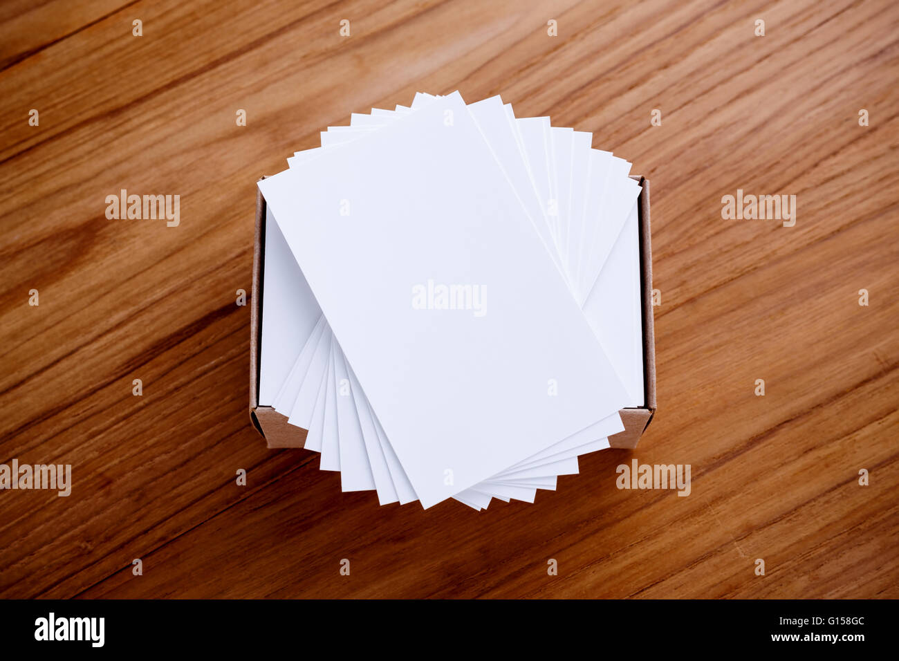 Business card blank stack mockup with kraft box on wood desk Stock ...
