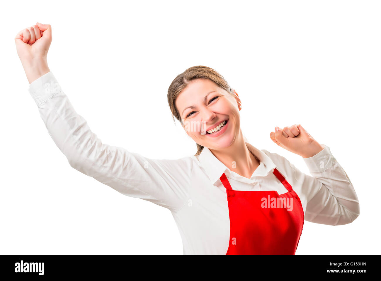 joyful pretty woman in a red apron on a white background rejoices - Stock Image