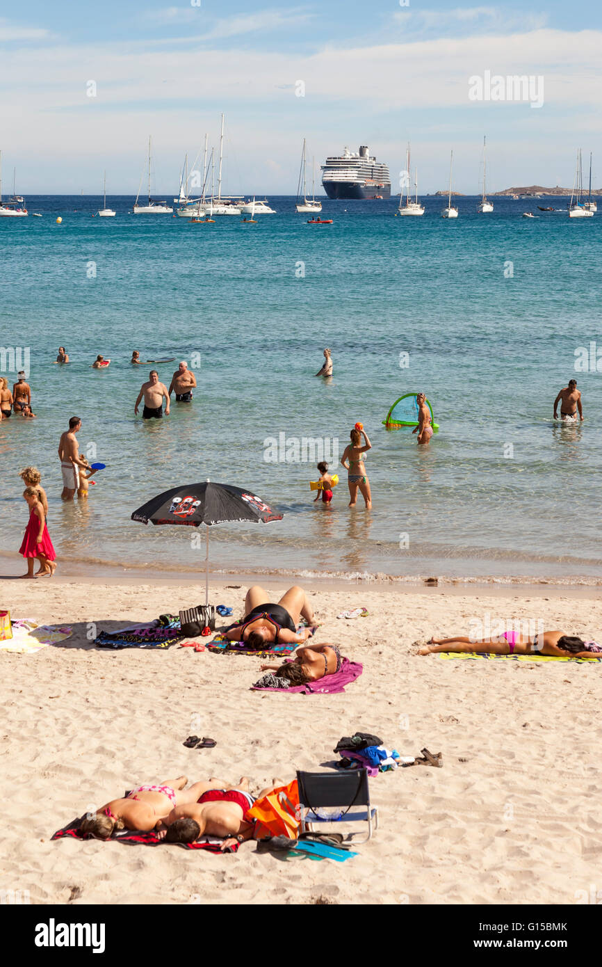 Tourists on a cruise stopover sunbathing on a beach, Calvi, Haute-Corse, Corsica, France Stock Photo