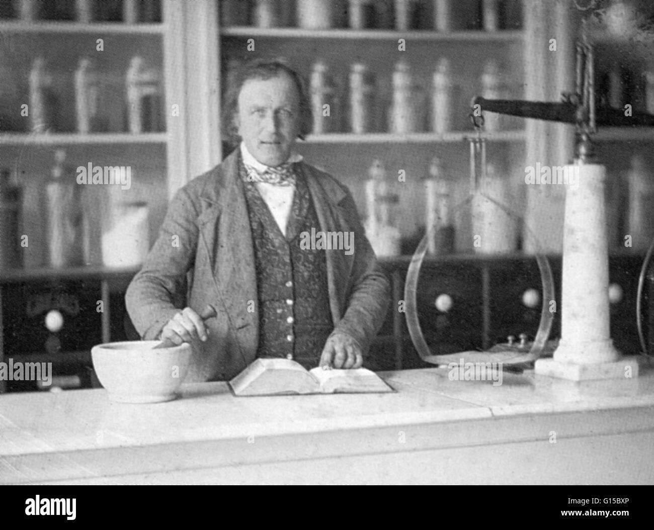 A daguerreotype from 1852 showing a chemist or apothecary at work in his shop. - Stock Image