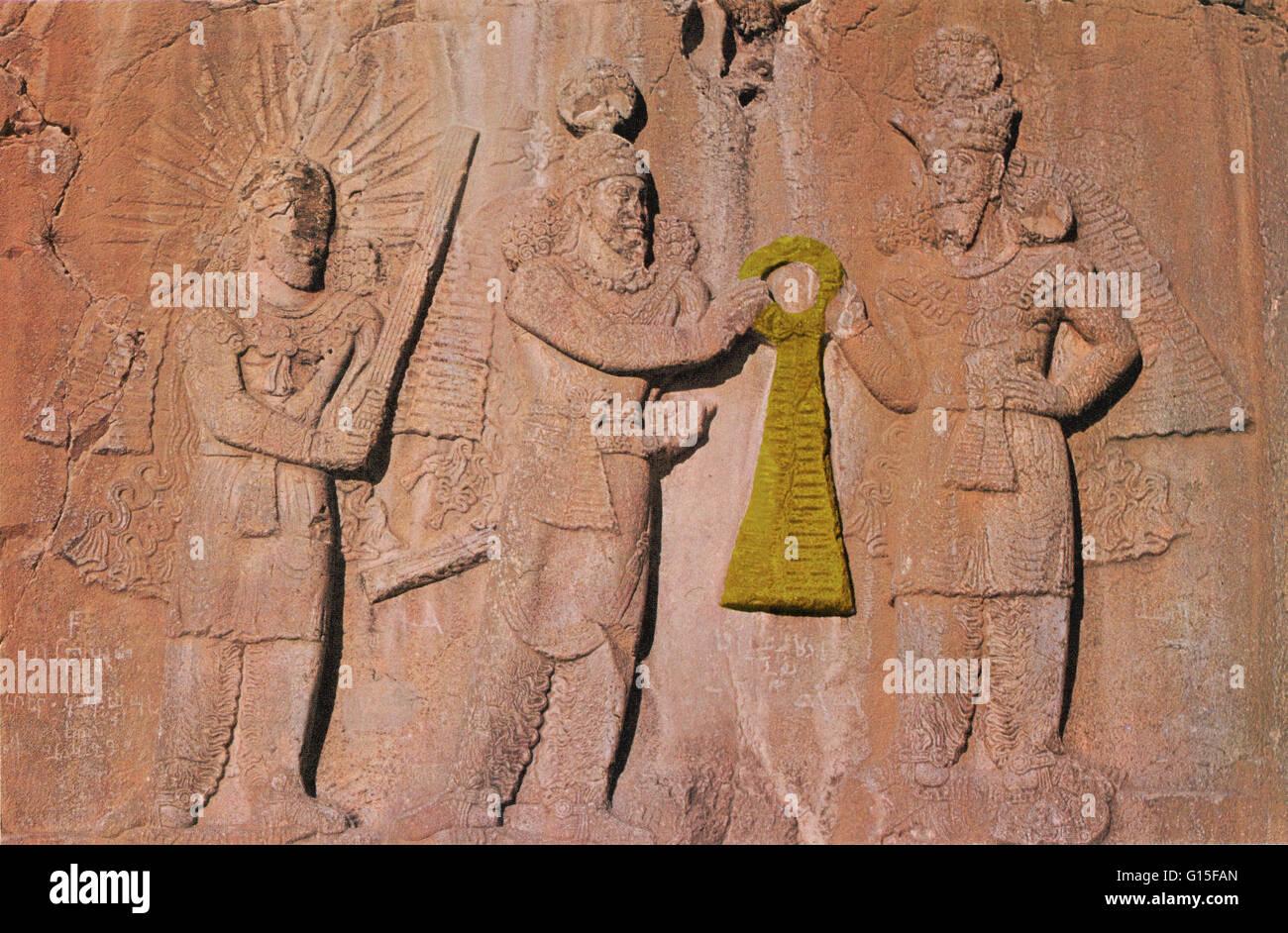 Ohrmazd, King Ardeshir II and Mithras. Ohrmazd (or Ahura Mazda) and Mithras flank the Persian king Ardeshir II. - Stock Image