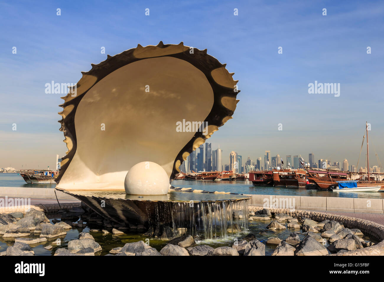 Pearl Monument with moored dhows and modern city skyline of West Bay, from Al-Corniche, Doha, Qatar, Middle East - Stock Image