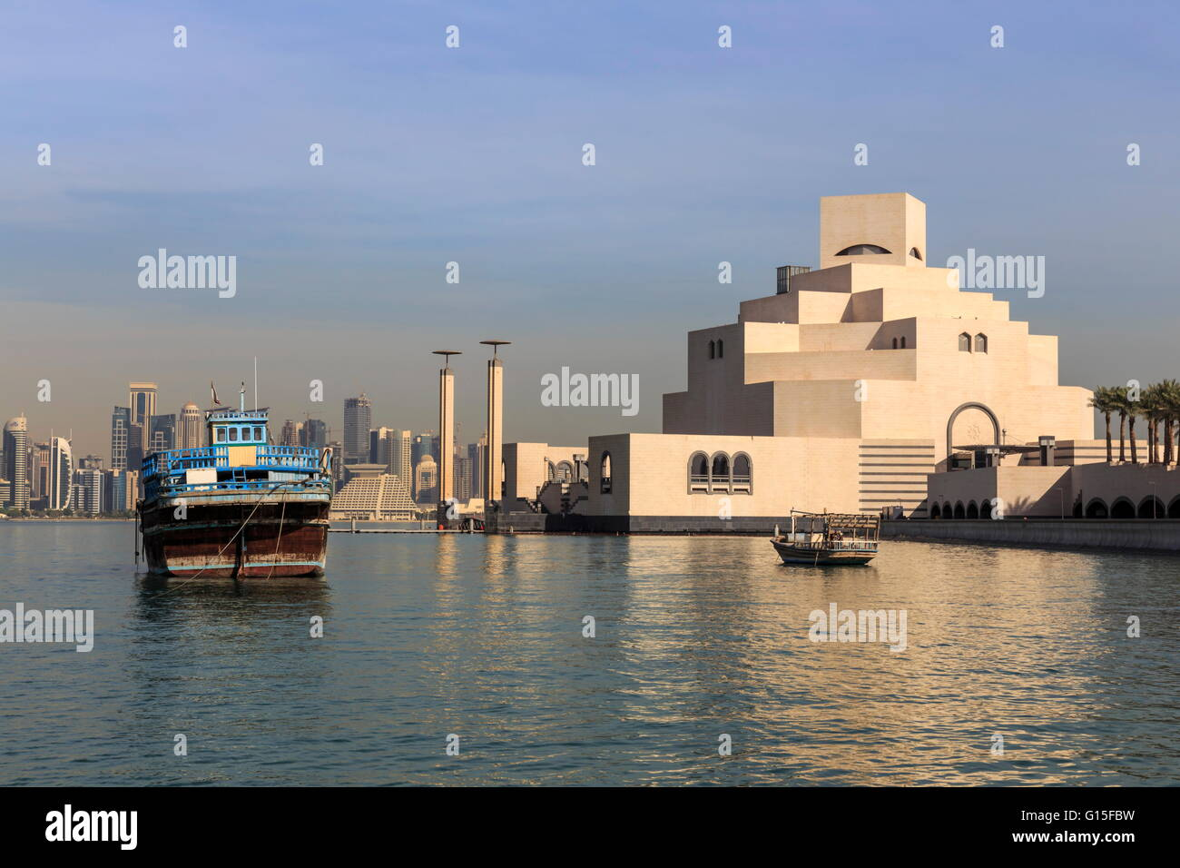 Museum of Islamic Art, dhow and modern city skyline of West Bay, from Al-Corniche, early morning, Doha, Qatar, Middle - Stock Image
