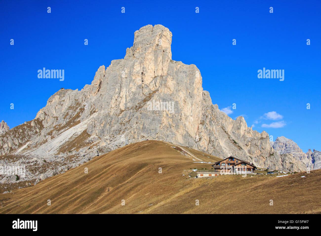 Autumnal view of the high rocky peak of Ra Gusela from Falzarego Pass, Dolomites of Belluno, Trentino-Alto Adige, - Stock Image