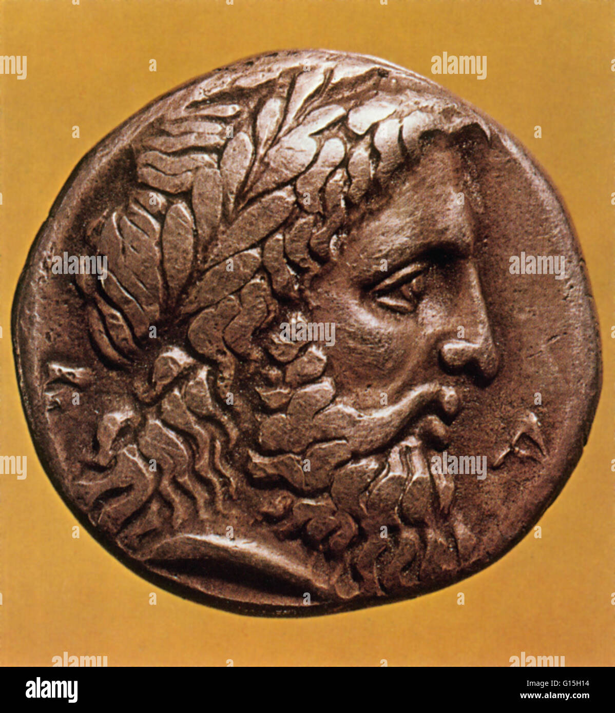 Greek god Zeus depicted on an ancient Greek coin from Elis. Zeus is the 'father of Gods and men' who rules - Stock Image