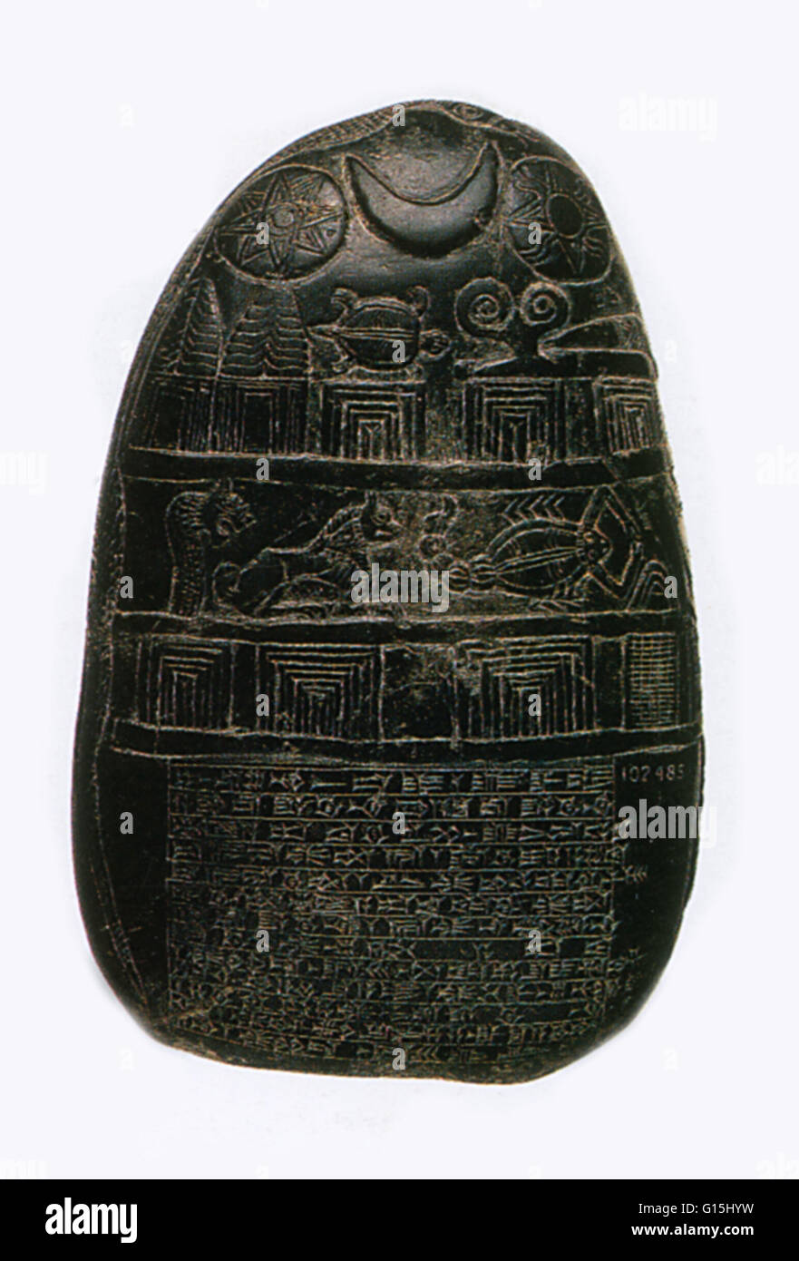 Babylonian boundary stone, or kudurru, depicting symbols of the gods and goddesses as witnesses to a legal agreement. - Stock Image