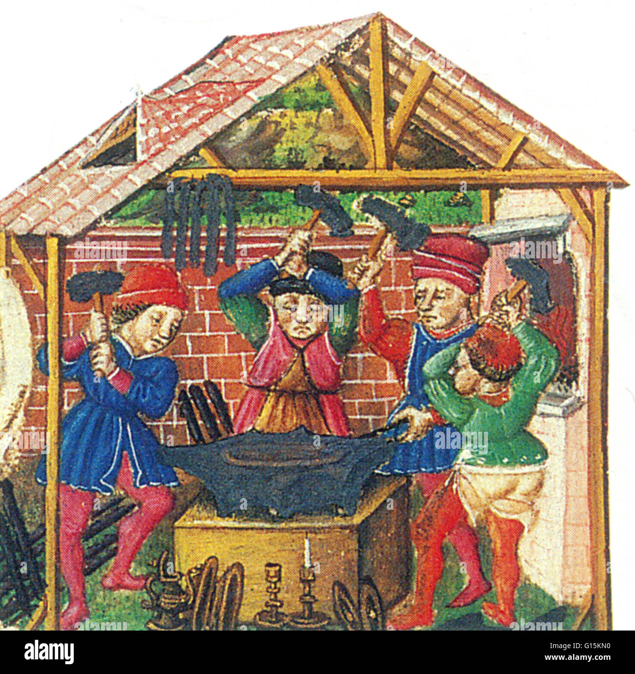 The smiths in this 15th century manuscript are hammering metal into shape over a solid iron anvil, their tools hanging - Stock Image