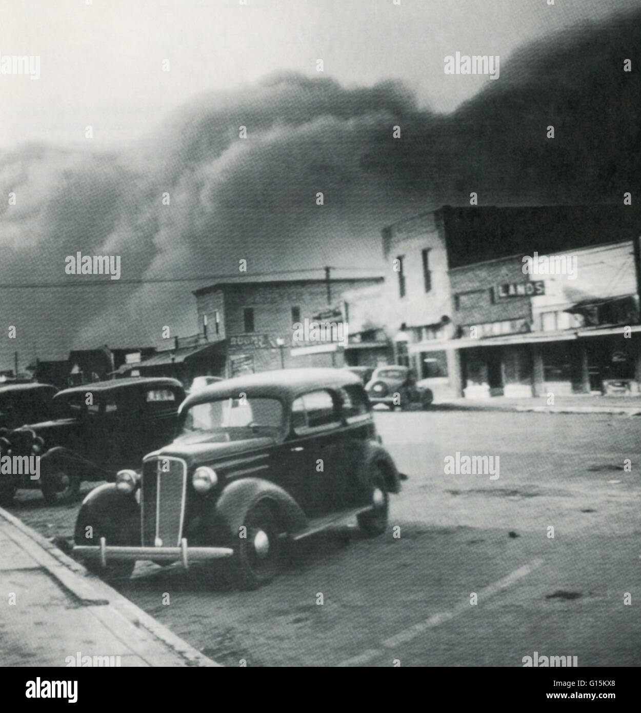 Elkhart, Kansas, crouches before one of the terrifying black blizzards that struck the towns in the Dust Bowl throughout - Stock Image