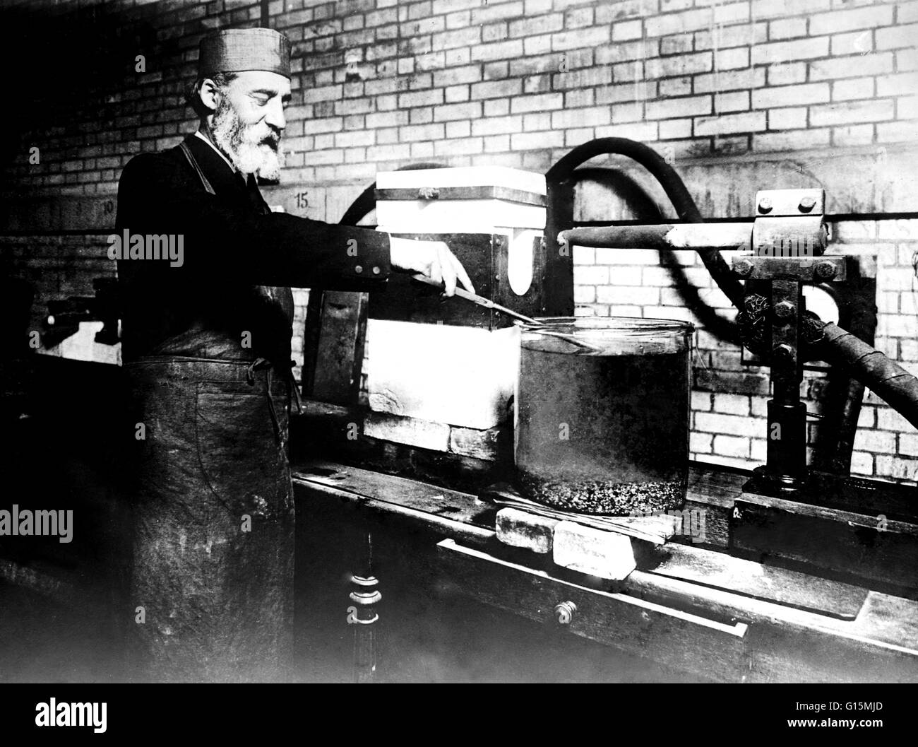 Moissan trying to create synthetic diamonds using an electric arc furnace. Ferdinand Frederick Henri Moissan (September - Stock Image