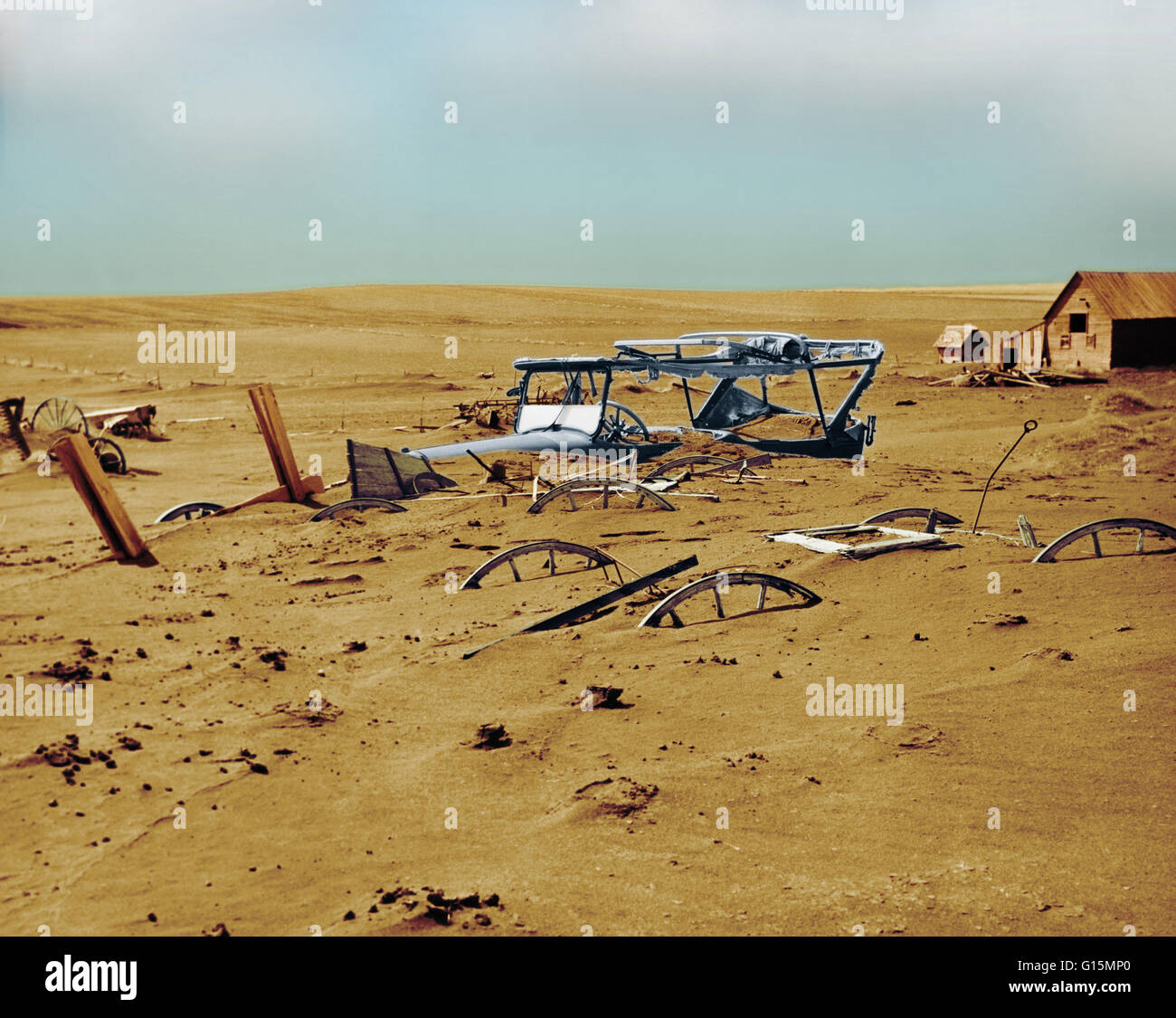 Machinery buried under dust and sand in a barn lot in Dallas, South Dakota, during the Dust Bowl.The Dust Bowl, - Stock Image