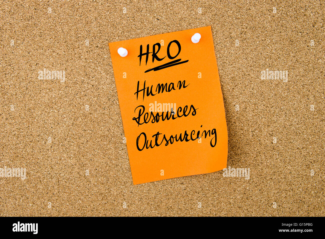 Business Acronym HRO Human Resources OutSourcing written on orange paper note pinned on cork board with white thumbtack, - Stock Image