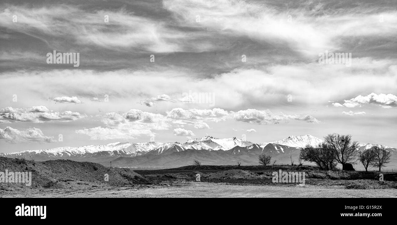 Mountains and countryside near Hamadan, Iran, dramatic black and white landscape. - Stock Image