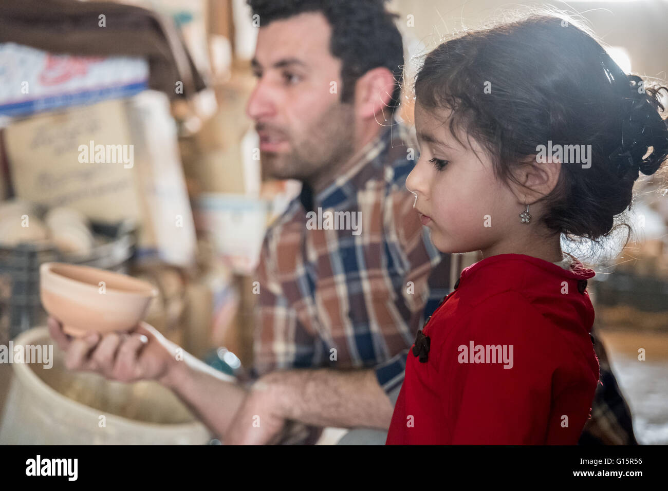 Father and daughter in pottery workshop in Lalejin, Hamadan Province, Iran, famous throughout the Middle East for - Stock Image