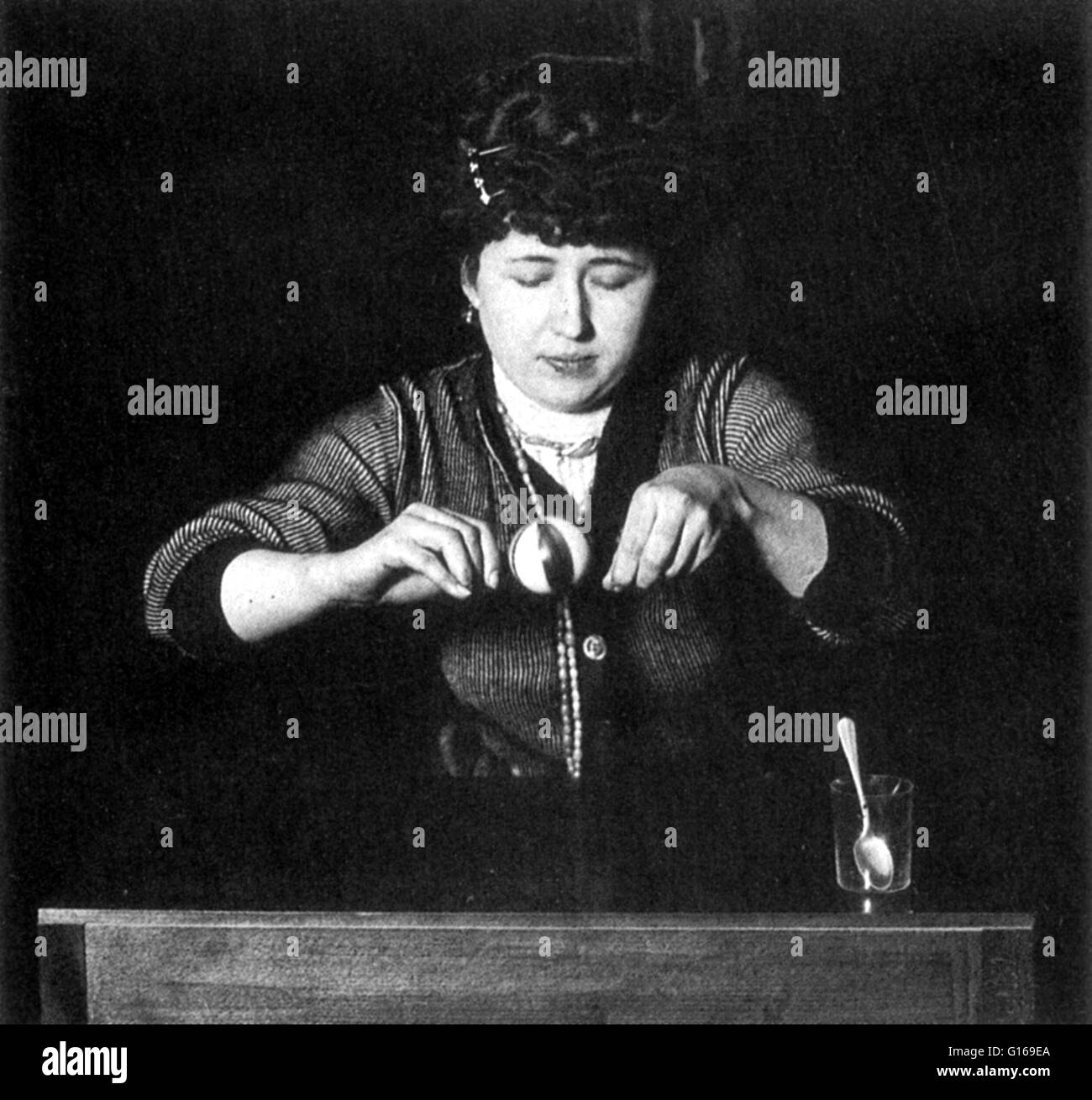 Tomczyk levitating a rubber ball. Stanislawa Tomczyk was a Polish Spiritualist medium in the early 20th century. - Stock Image