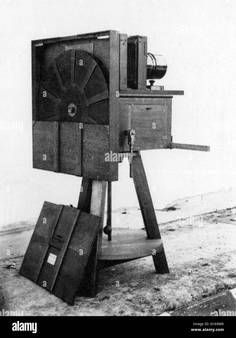 Marey's fixed-plate chronophotography machine, with ten slit-disk that acts as a shutter, on the ground is the - Stock Image
