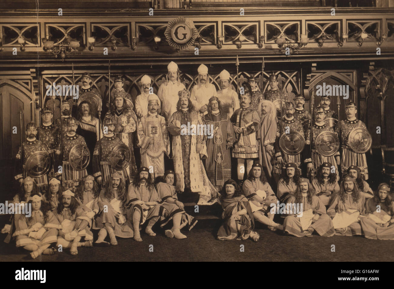 Group portrait of Freemasons of Anglo-Saxon Lodge, seated and standing, in ceremonial dress, 1902. Freemasonry is - Stock Image