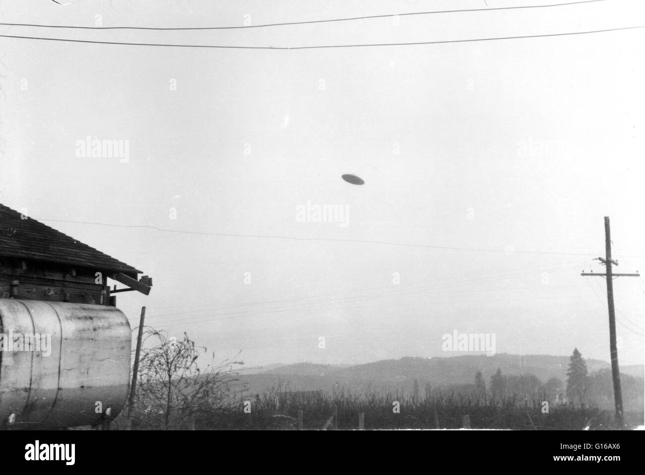 The McMinnville UFO photographs were taken on a farm near McMinnville, Oregon, in 1950. The photos were reprinted - Stock Image