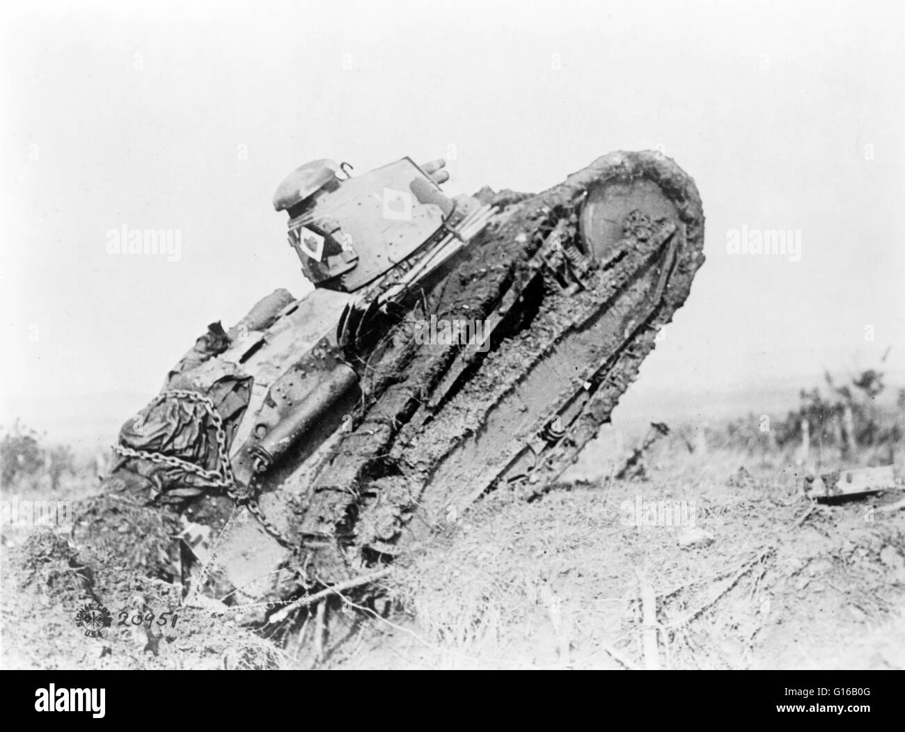 Tank ploughing its way through a trench and starting toward the German line, during World War I, near Saint Michel, - Stock Image
