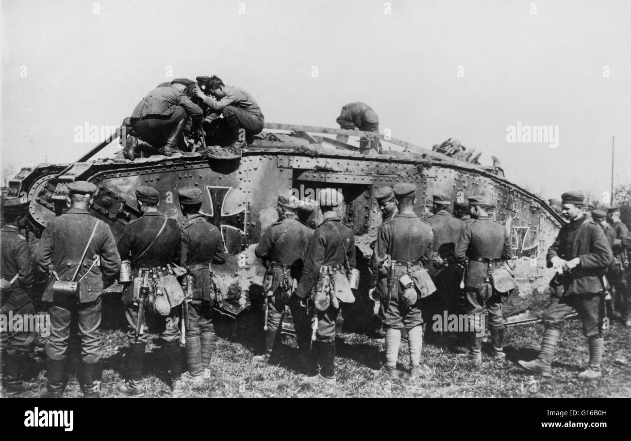 German soldiers standing around a German tank as other soldiers work on the tank, circa 1914-18. Tanks in World - Stock Image