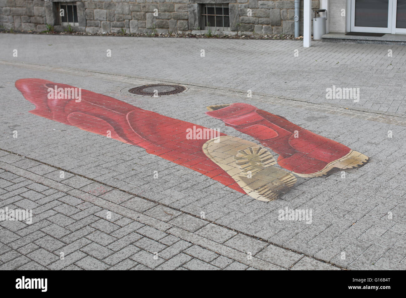Street Mural on pavement with raindrops, Montabaur, Germany, crop of G16B4K - Stock Image