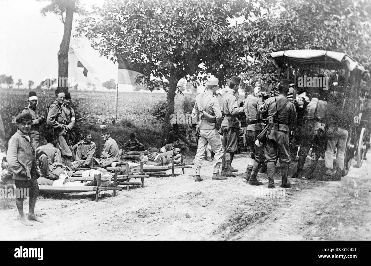 Austrian soldiers with an ambulance in the road during World War I. The Austro-Hungarian Army was the ground force - Stock Image
