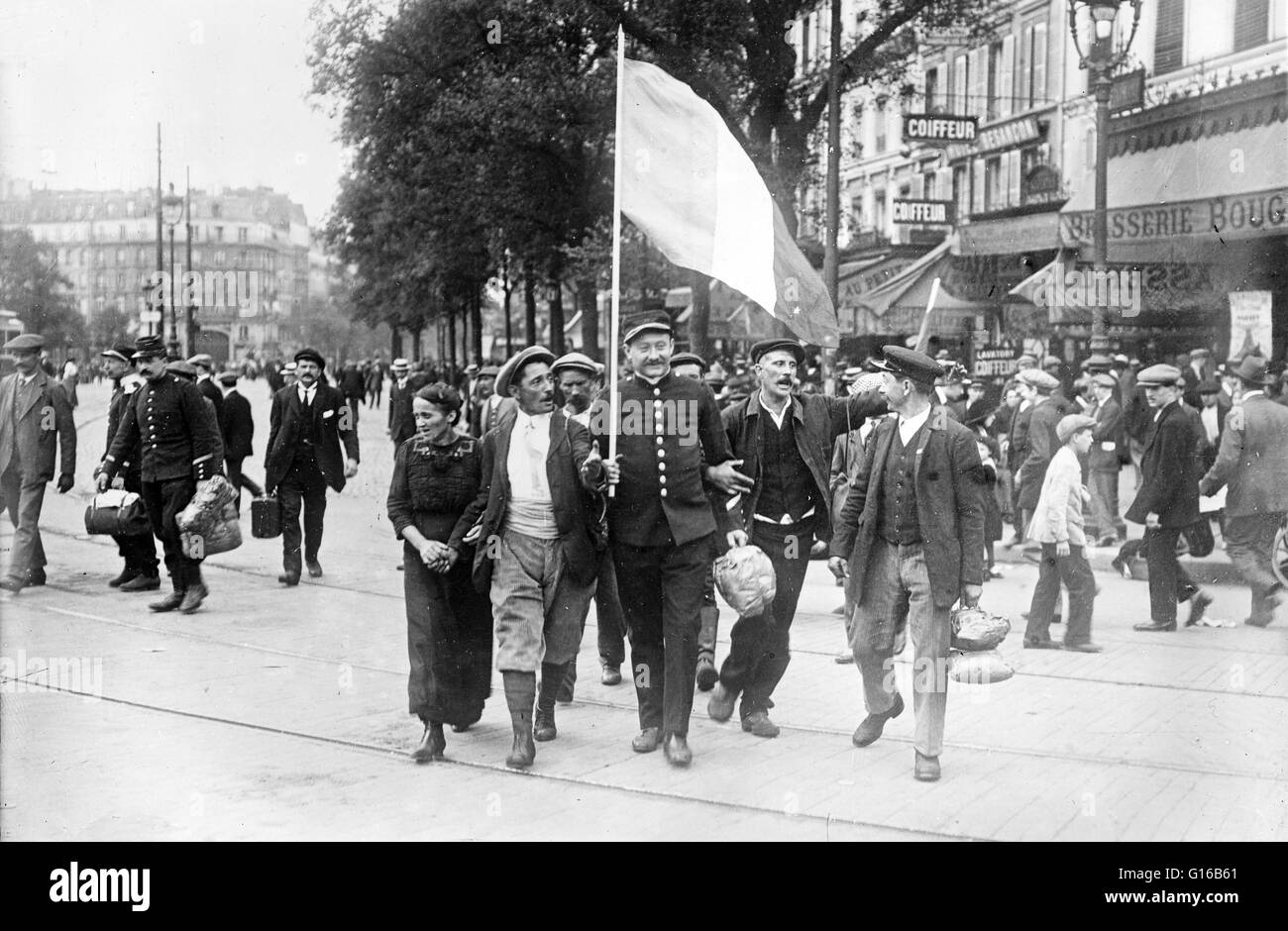 French reservist soldiers marching in front of the Brasserie Bougeneaux (9 Rue de Strasbourg), Paris, France, on - Stock Image