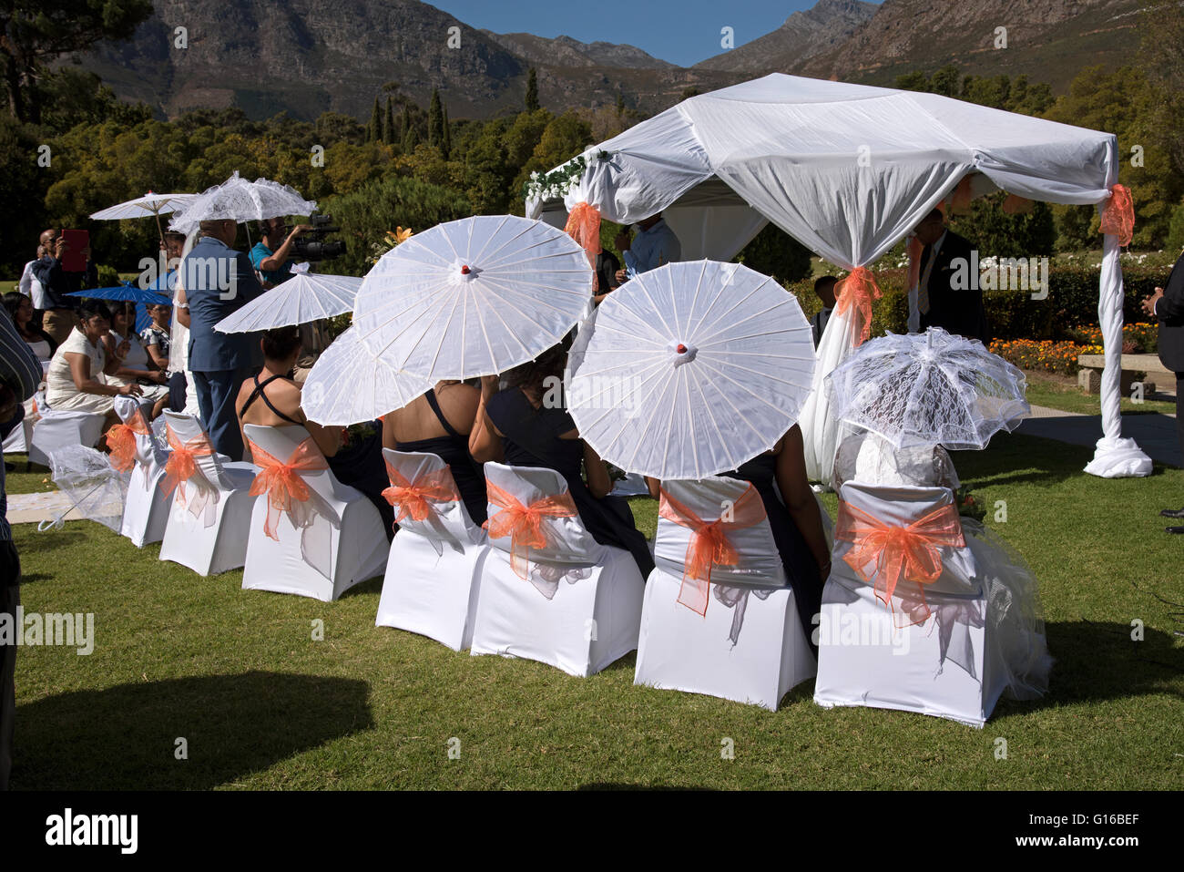 African wedding party service people guests bride and groom traditional getting wed marriage ceremony Huguenot monument Stock Photo