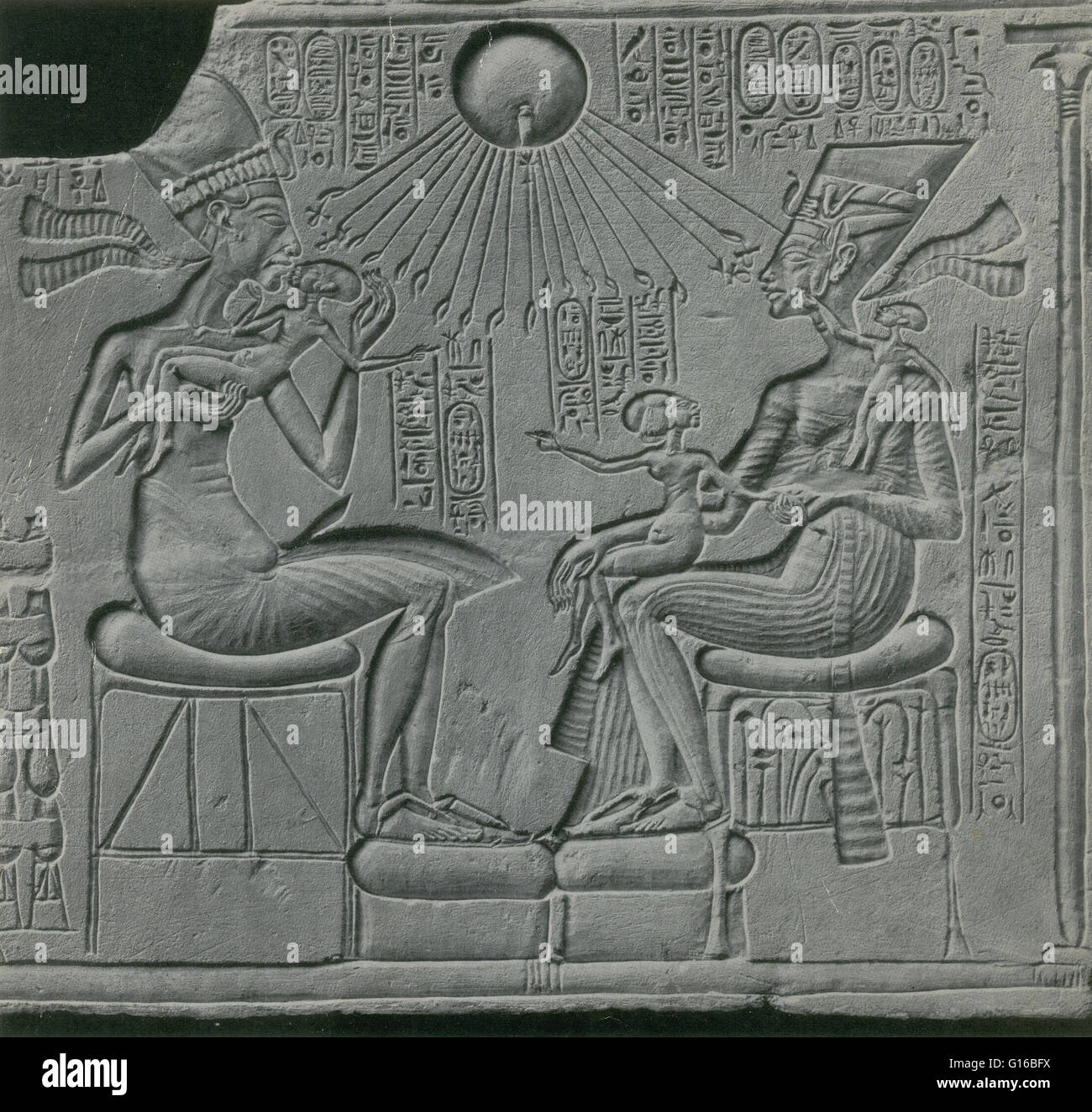 Caption: 'Sunk-relief depicting Egyptian pharaoh Akhenaton, his wife Nefertiti, and three of their daughters, - Stock Image