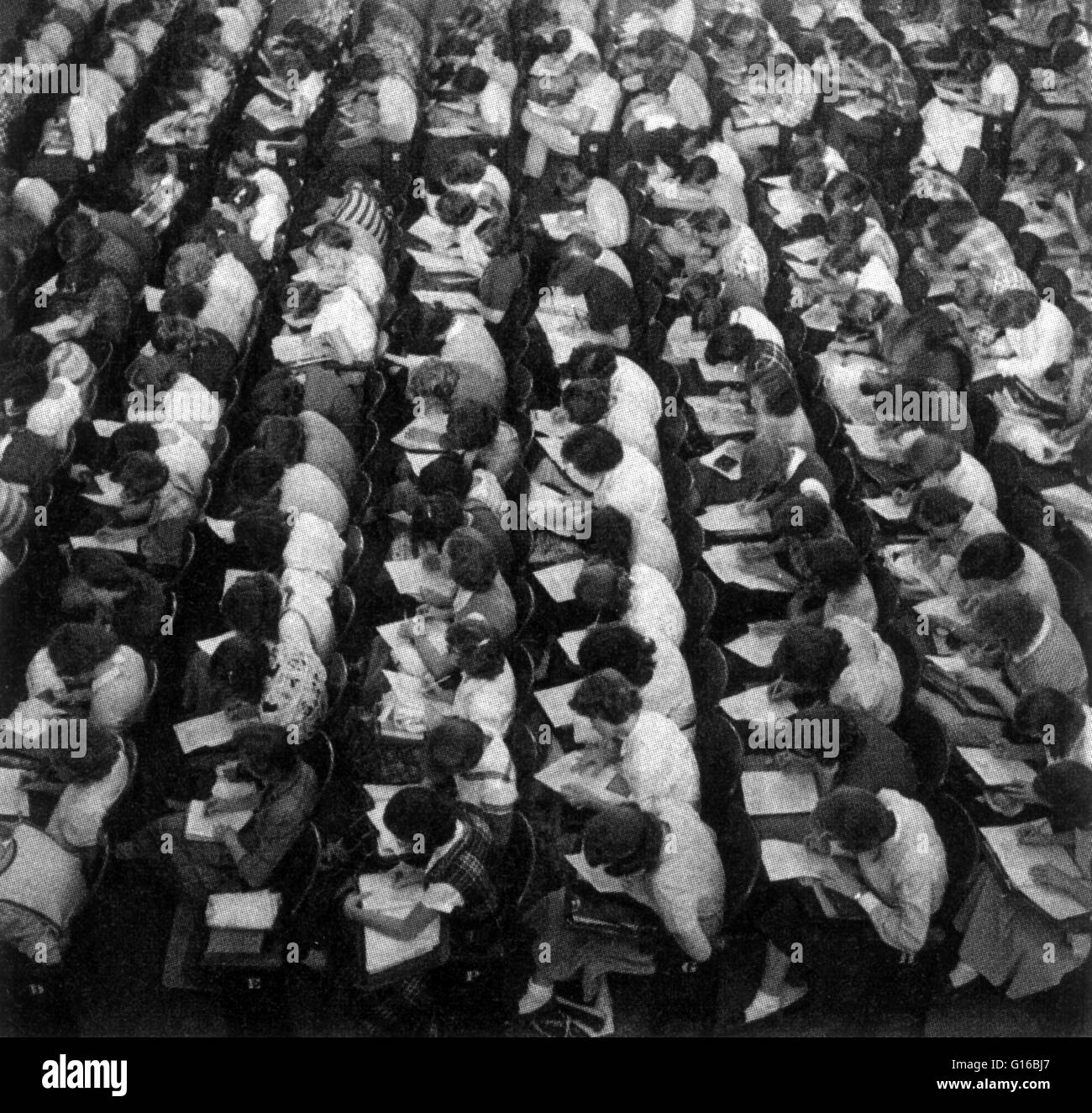 Students take the Scholastic Aptitude Test (SAT) in Lincoln, Nebraska, 1953. The SAT is a standardized test for - Stock Image