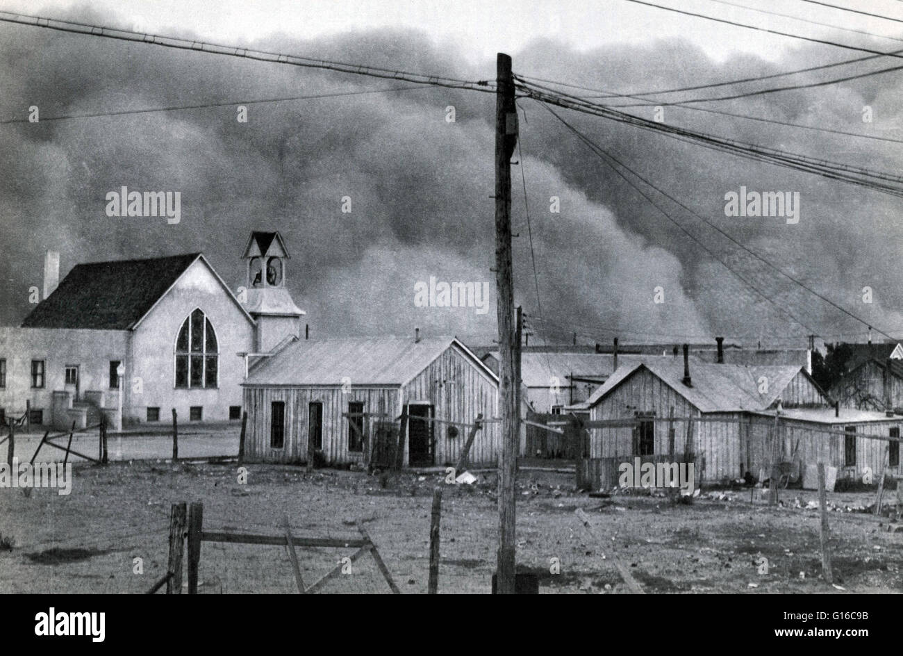 Black roller dust storm is rushing toward Clayton, New Mexico, May 29, 1937. It was one of worst ever to strike - Stock Image