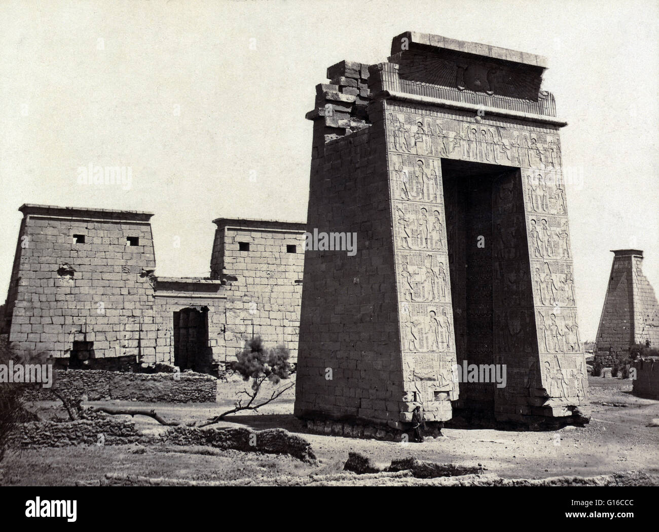 Propylon (triumphal arch) and pylons of the Temple of Ramses IV in Thebes, photographed by Maison Bonfils, circa - Stock Image