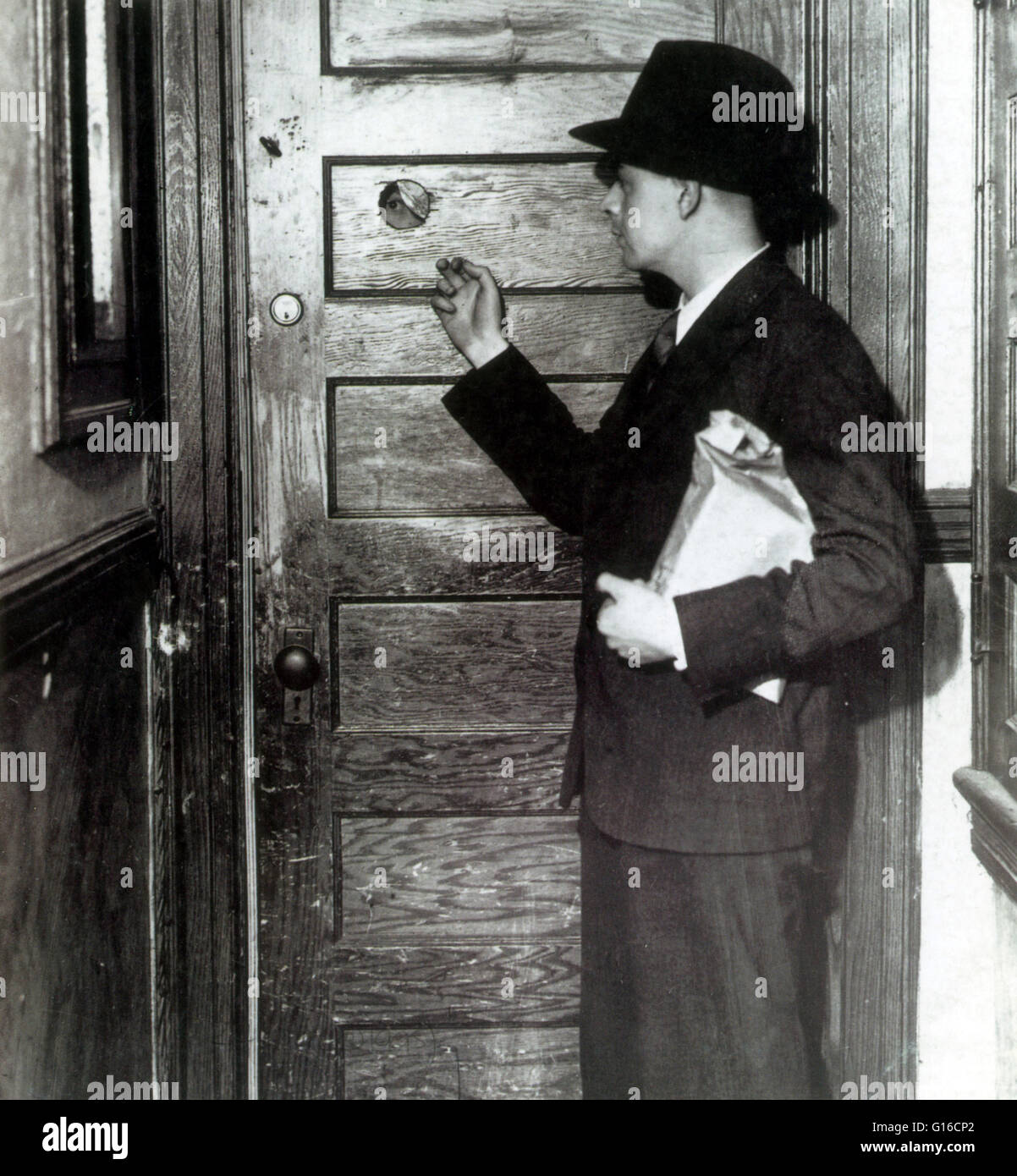A Patron Knocks At The Door Of A Speakeasy. Note Peephole In The Door. A  Peephole Allowed People Inside The Security Of Seeing Outside Without  Opening The ...