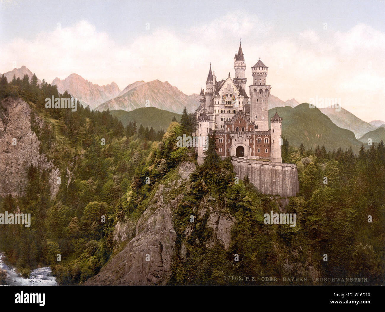 Neuschwanstein Castle is a 19th century Romanesque Revival palace on a rugged hill above the village of Hohenschwangau - Stock Image