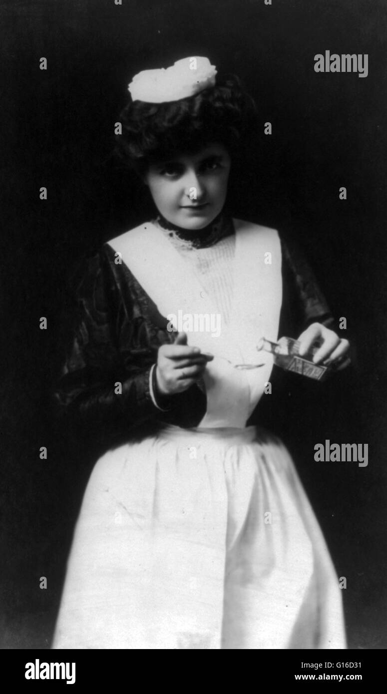 Woman in nurse's uniform holding spoon and bottle, 1907. In the early 20th century most medicines that people - Stock Image
