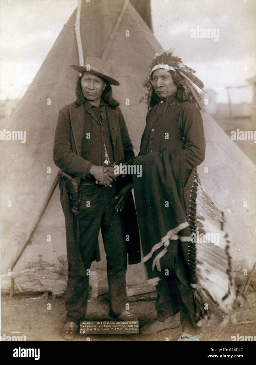 Two Oglala chiefs, American Horse (wearing western clothing and gun-in-holster) and Red Cloud (wearing headdress), - Stock Image
