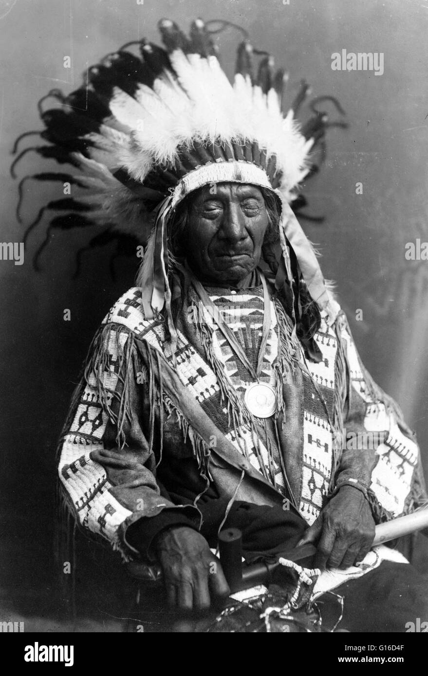 Chief Red Cloud, holding peace pipe, circa 1900s. Red Cloud (1822 - December 10, 1909) was a very strong war leader - Stock Image