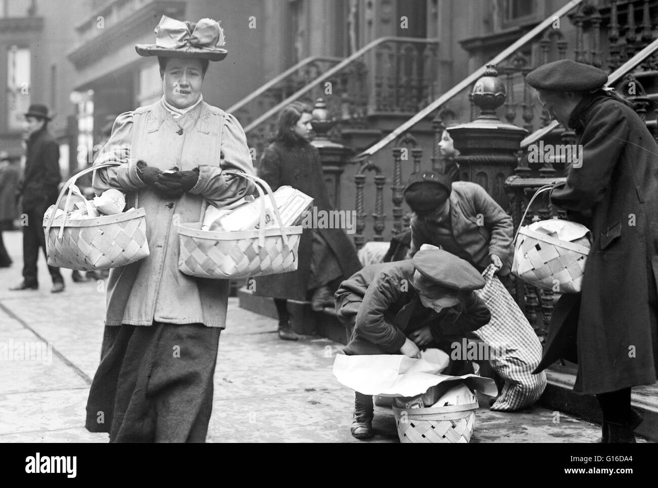Entitled: 'Taking home baskets, Salvation Army Christmas dinner, New York.' The Salvation Army administers - Stock Image