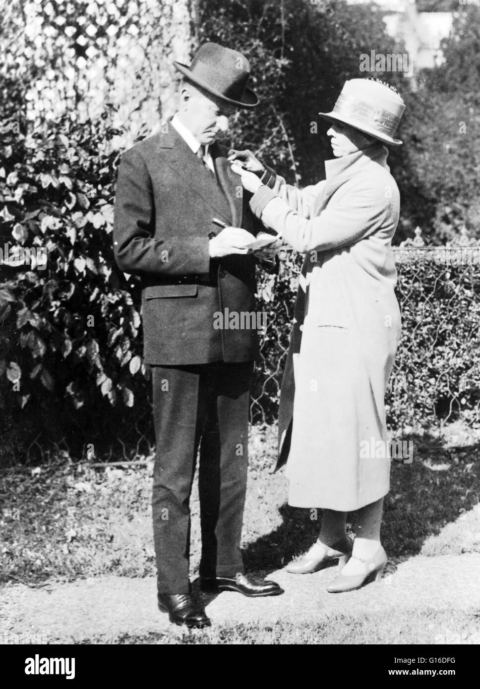 Mrs. Calvin Coolidge enrolls the President in the American Red Cross, October 29, 1924. John Calvin Coolidge, Jr. Stock Photo