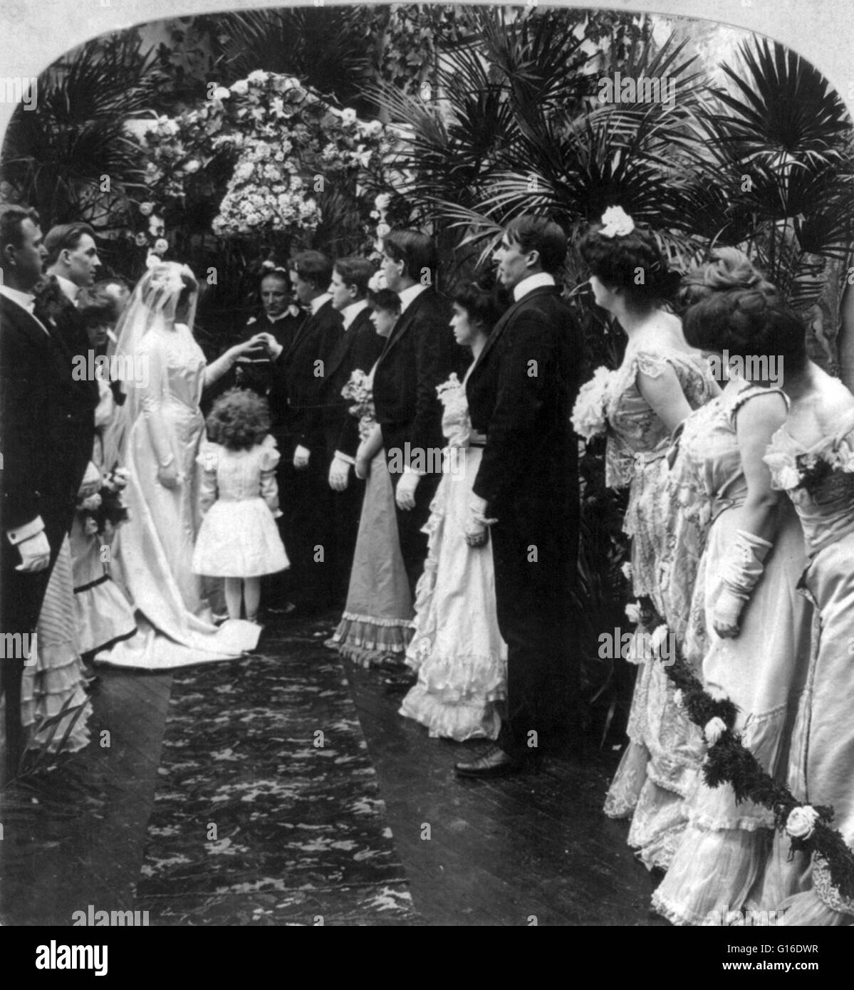 Entitled: 'With this ring I thee wed' shows a wedding scene with members of wedding party in foreground; - Stock Image