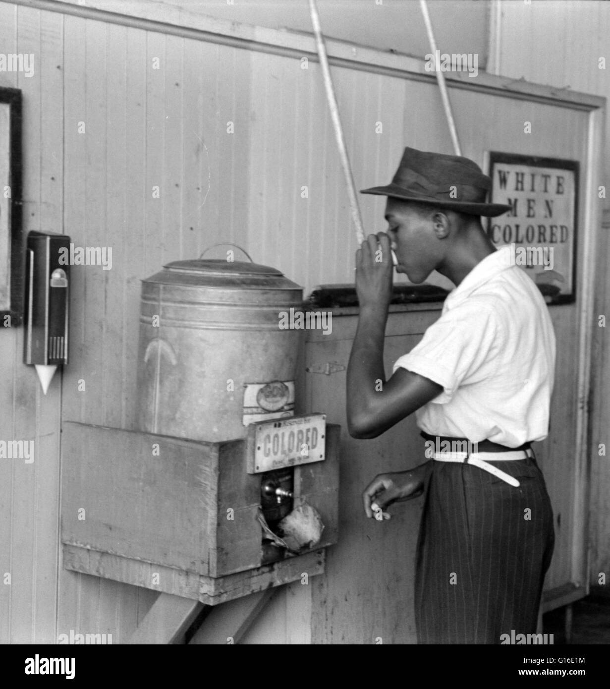 Entitled: 'Negro drinking at 'Colored' water cooler in streetcar terminal, Oklahoma City, Oklahoma.' - Stock Image