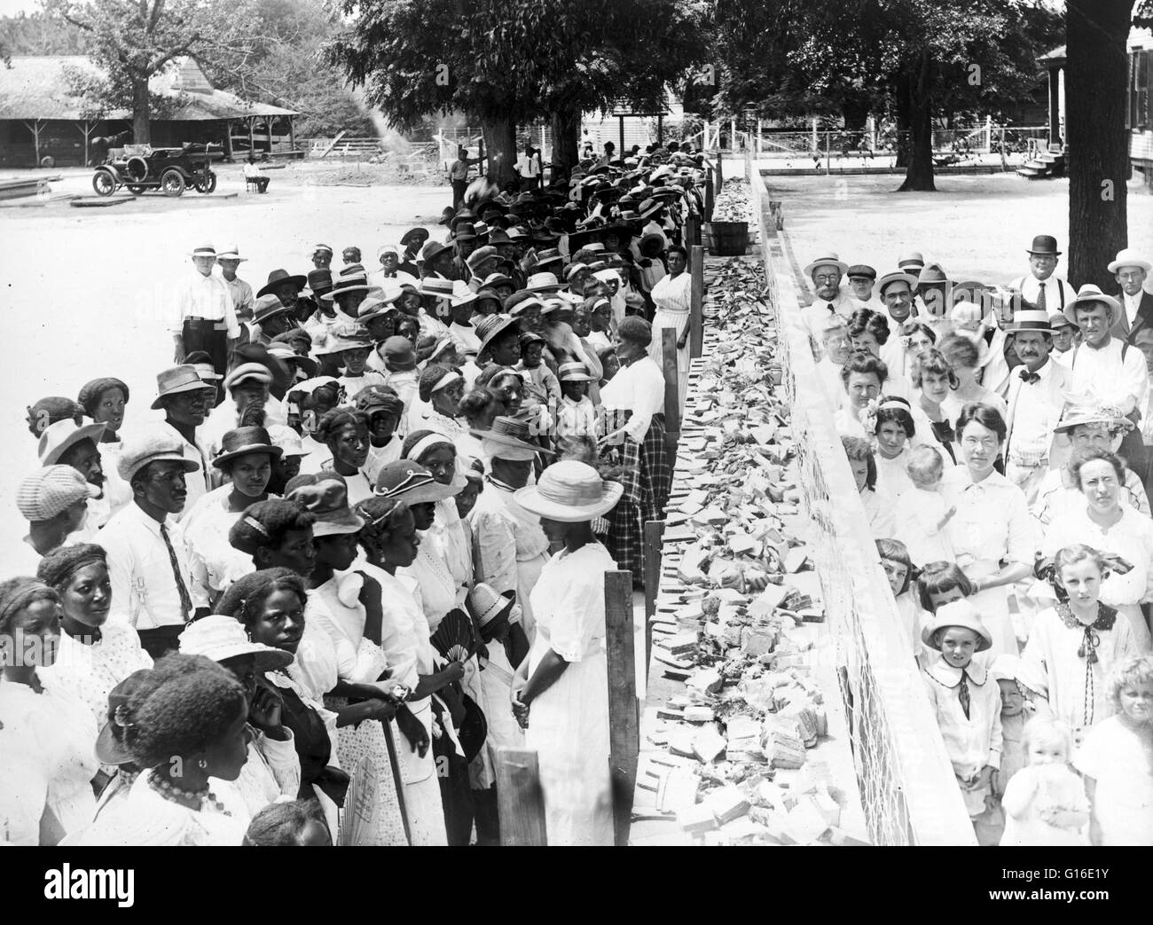 Entitled: 'F.M. Gay's annual barbecue given on his plantation every year' shows crowds of African-American - Stock Image