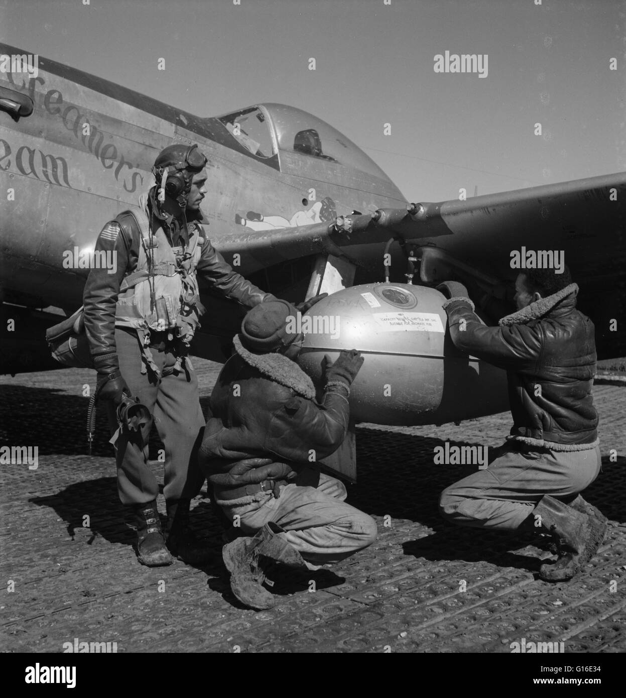 Entitled: 'Gleed and two unidentified Tuskegee airmen, Ramitelli, Italy' shows Tuskegee airman Edward C. - Stock Image