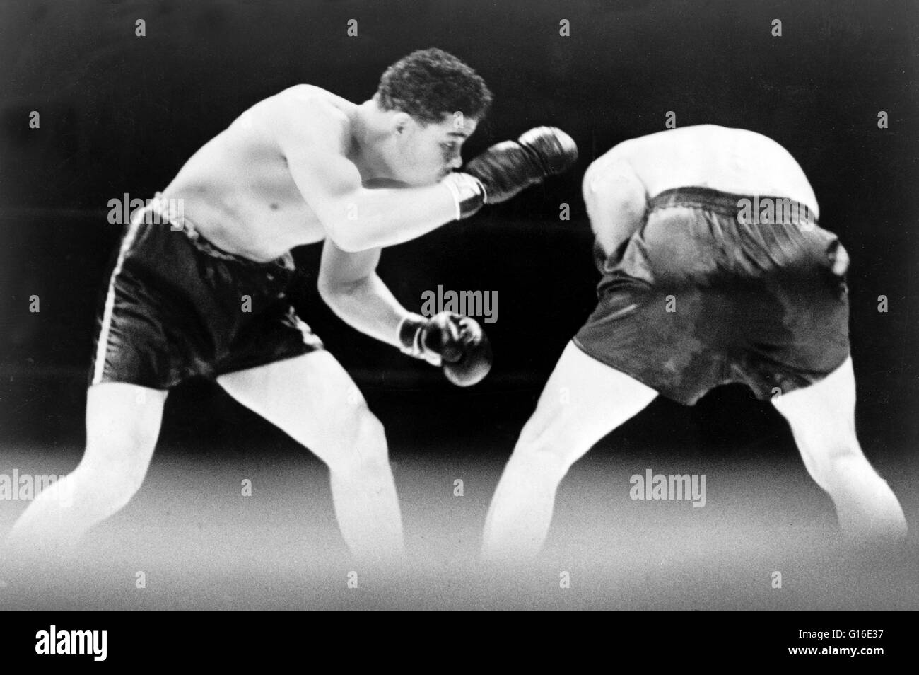 Entitled: 'Joe Louis looks for an opening during boxing match with Max Schmeling.' In 1936 Louis was ranked - Stock Image