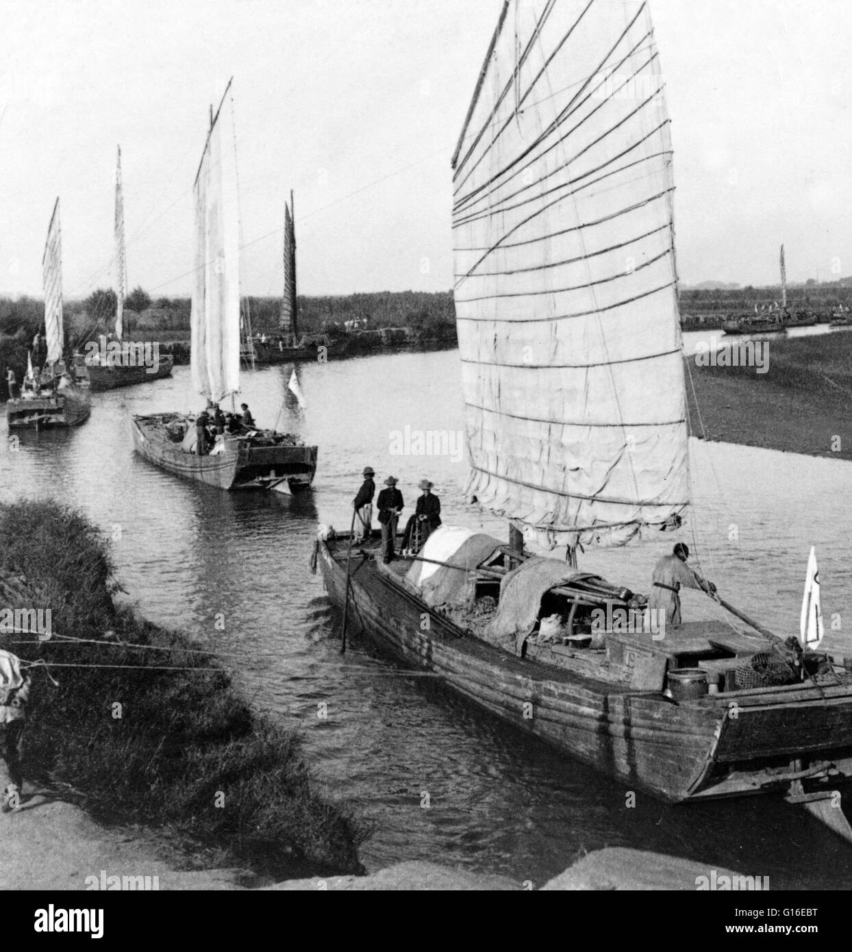 Entitled: 'Junk flotilla on the Peiho River - transporting U.S. Army stores from Tientsin to Peking, China.' - Stock Image