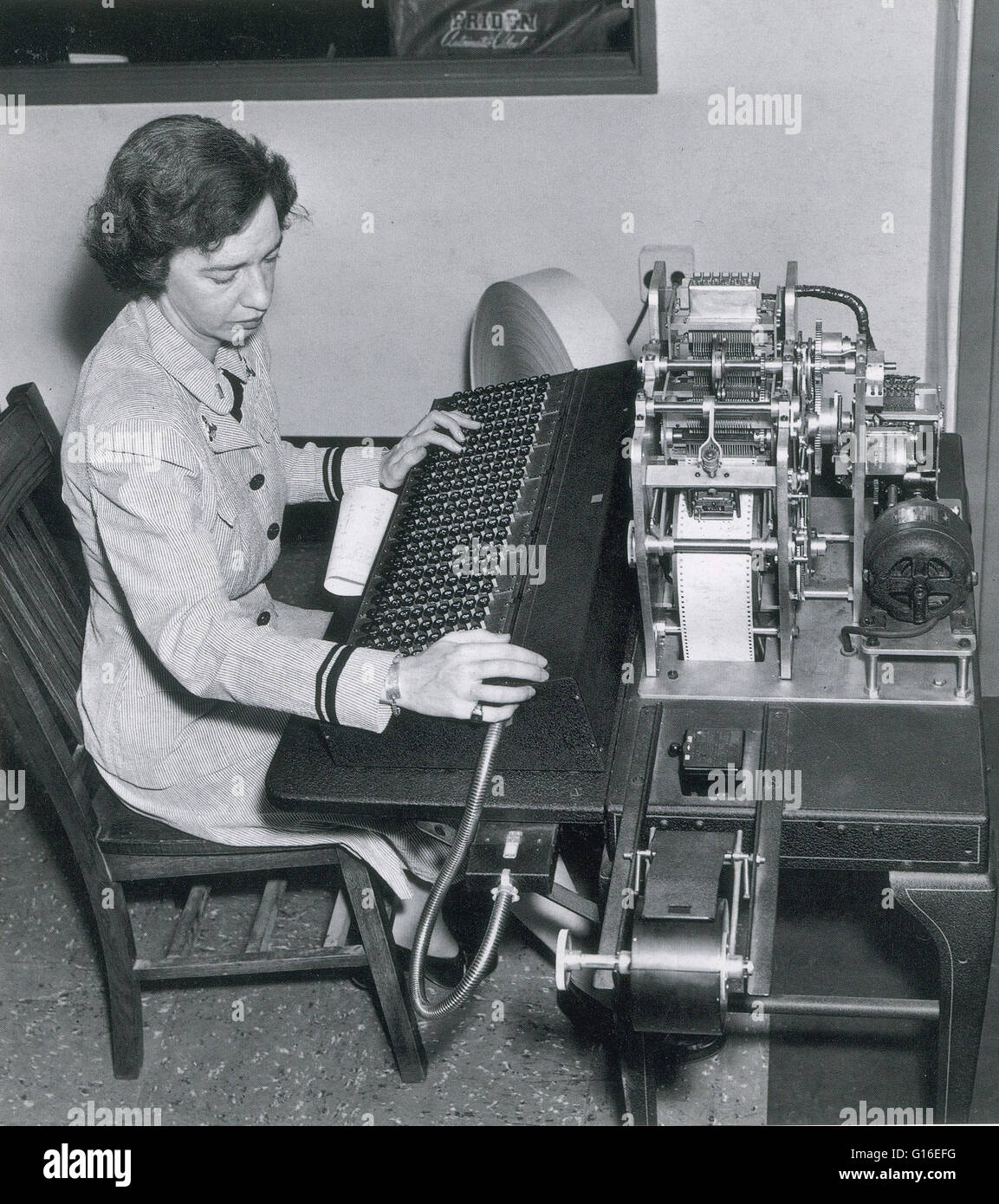Hopper works on a manual tape punch computer, 1944. Grace Murray Hopper (December 9, 1906 - January 1, 1992) was - Stock Image