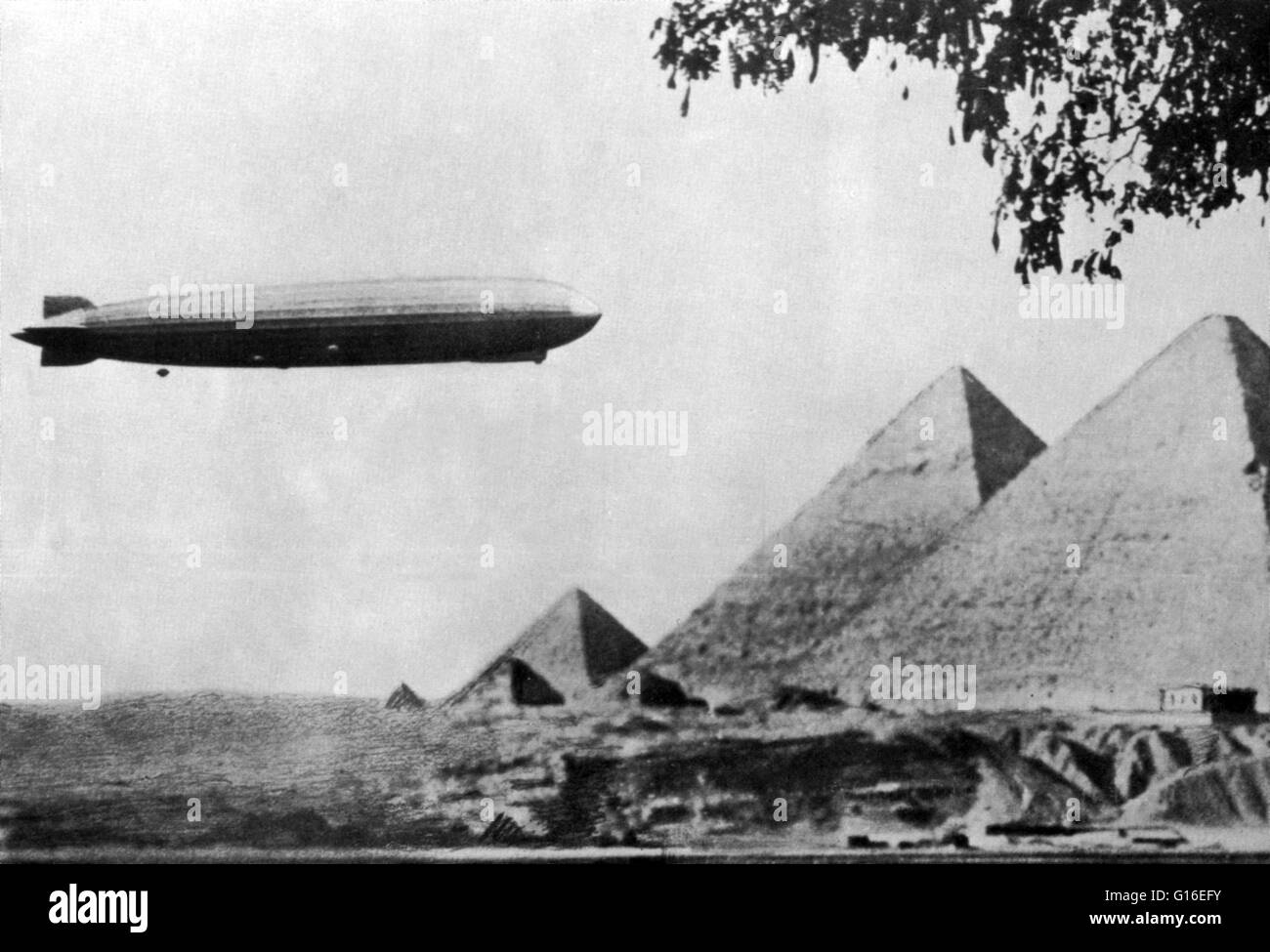 """Entitled: """"Graf Zeppelin over Giza pyramids, 1931."""" LZ 127 Graf Zeppelin was a German-built and operated, passenger-carrying, hydrogen-filled, rigid airship which operated commercially from 1928 to 1937. It was named after Ferdinand von Zeppelin, who was Stock Photo"""