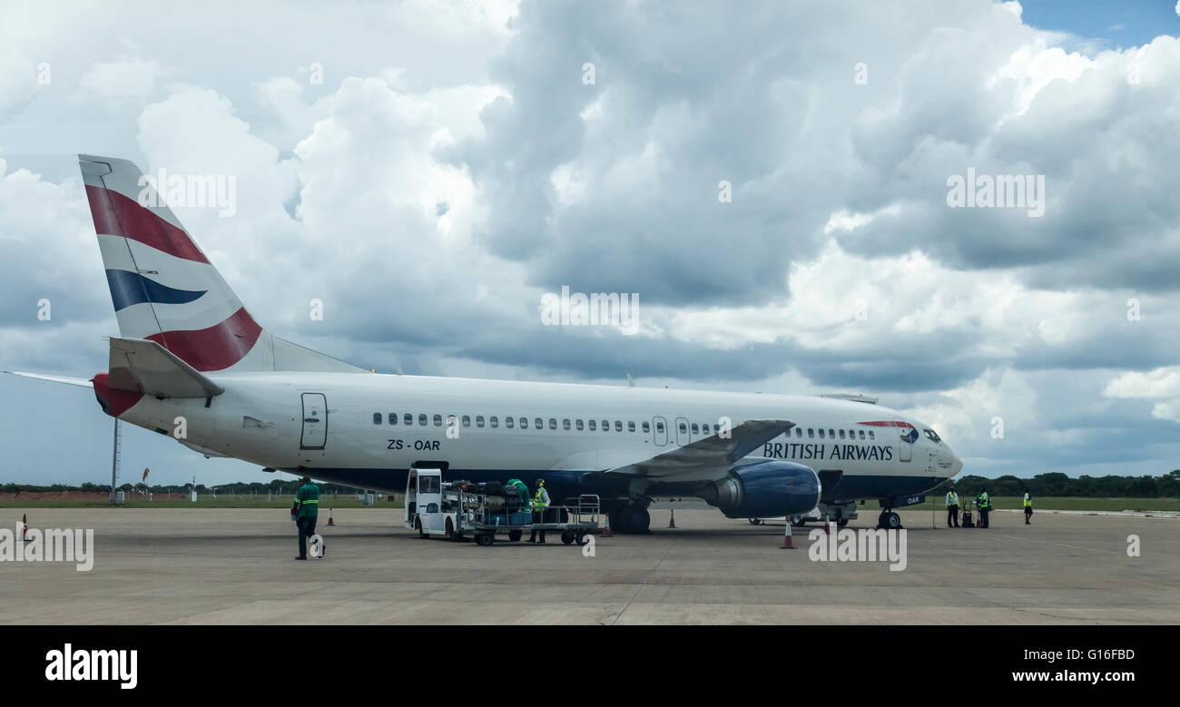 Luggage being loaded onto Comair Boeing 737-47 aeroplane ZS-OAR - O. R. Tambo International Airport Johannesburg, - Stock Image