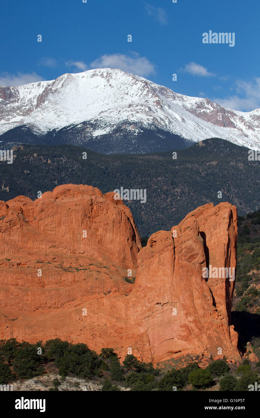 Close up view of Pikes Peak Mountain in Colorado Springs with a red rock formation in the foreground - Stock Image